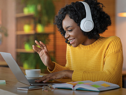 Female student using headphones